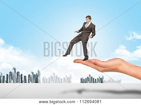 Businessman walking from edge of hand