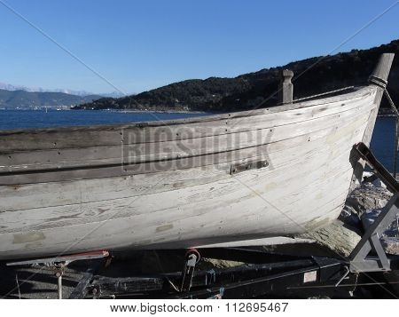 Hull Of Wooden Fishing Boat Under Repair In Dry Dock In Portovenere, Province Of La Spezia, Italy