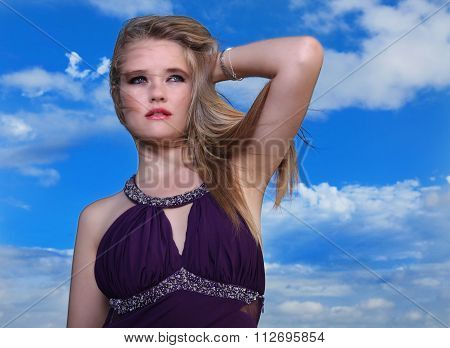Blonde Lady In Evening Dress With Blue Sky