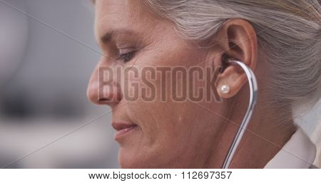 Close-up Of Doctor Listening With Stethoscope