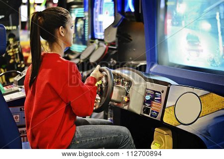 Girl in the arcade game