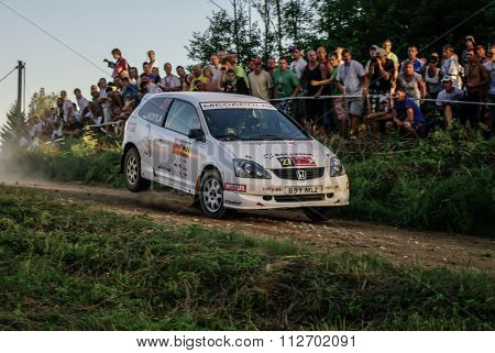 South Estonia., Estonia, 18 July 2010: Koitla Kaspar Jump At Honda Civic Type-r In Mad Crocc Rally 2