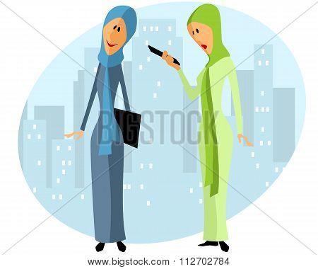 Two muslim businesswomen