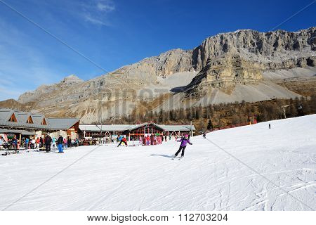 Madonna Di Campiglio, Italy - December 18: The Ski Slope And Skiers At Passo Groste Ski Area On Dece