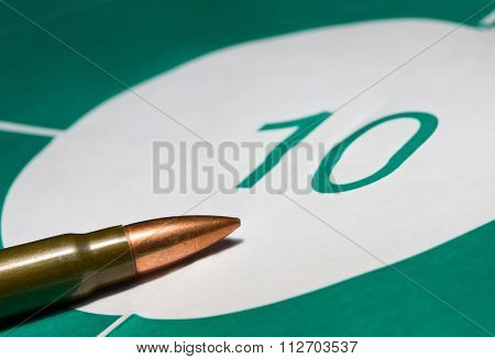 Macro Of Bullet On Bullseye