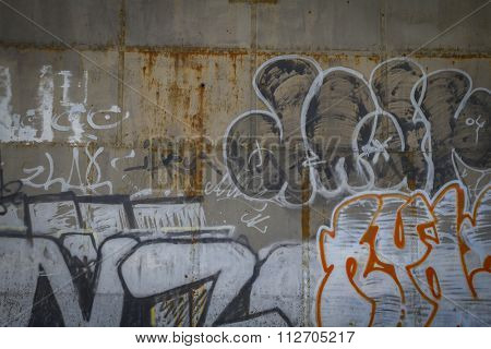Grafitti, old abandoned train station, rusty iron walls
