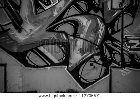 segment of a street art grafitti in black and white ink