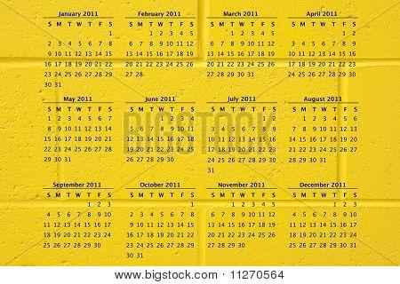 2011 Kalender auf Yellow Brick Wall Hintergrund