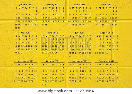 2011 Calendar On Yellow Brick Wall Background