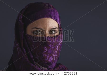 ethnic Beautiful arabic woman with traditional burqa veil