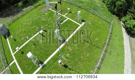 Meteorological station with measurement equipment for weather forecast at spring sunny day. Aerial view