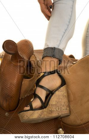 Close Up Of Womans Foot On Saddle
