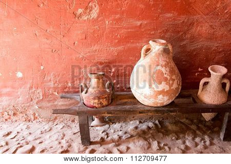 Terracotta Vase And Amphora On Wooden Bench In Archaeological Site