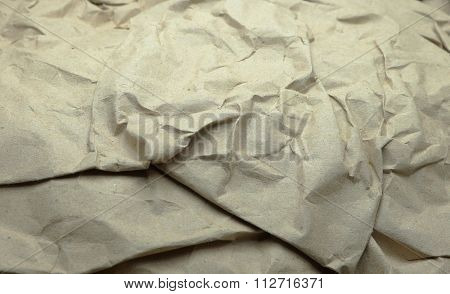 Closeup of brown wrinkled paper texture background.