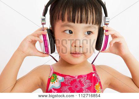 Chinese Little Girl On Headphones