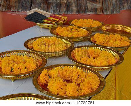 worship garland on golden tray with pedestal