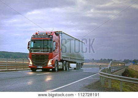 Red Volvo FH Semi and Dark Sky