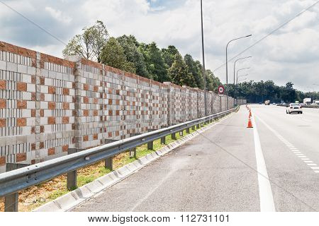 Concrete Noise Barrier Wall Along Busy Noisy Highway