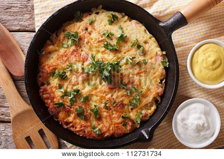 Potato Pancakes With Herbs Close-up In A Frying Pan. Horizontal Top View