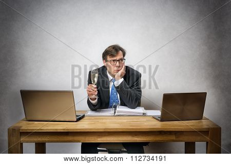 Lonely Business Man With Champagne Glass