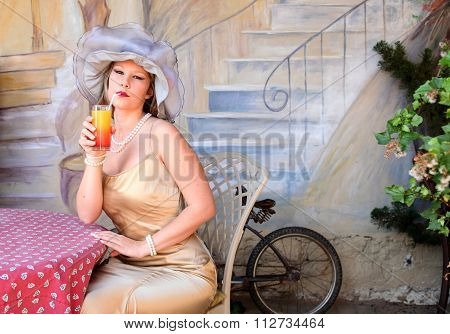 Blonde Lady Sipping Cocktail In Cafe