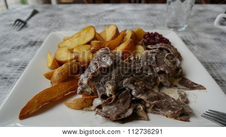 Reindeer meat and french fries