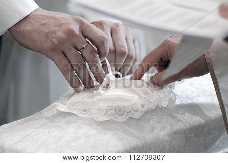 Groom And Priest Hands