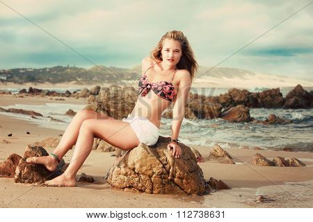 A Beautiful Blonde Lady In Her Bikini On A Beach In Africa