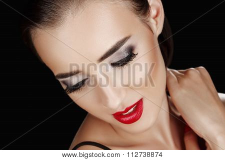 Beauty Woman With Perfect Makeup. Red Pink Lips And Nails. Beauty Girl's Face Isolated On Black