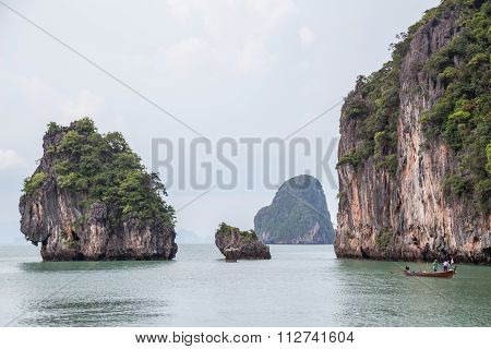 Phuket, Thailand - Circa September 2015: Boat Sails Near Limestone Cliffs Of Andaman Sea, Phang Nga