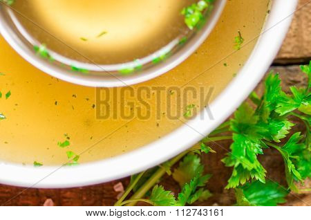 Closeup Of Broth In A Saucepan And Ladle