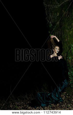 Sensual Woman Near Tree