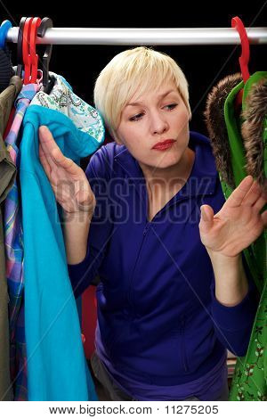 Choosing Clothes At Rack