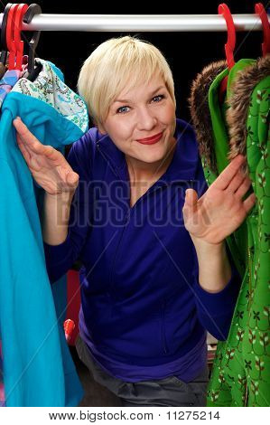 Woman Looks Out Of Her Clothing Rack