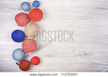 Vintage Toned Yarn Balls On Wooden Boards.