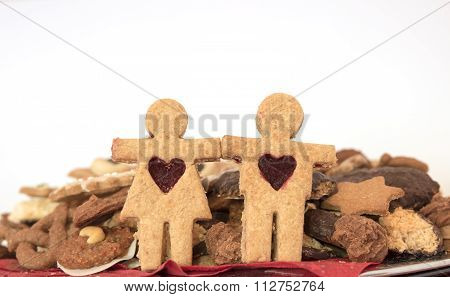 Christmas Cookie Couple, Against Plate With Handmade Cookies
