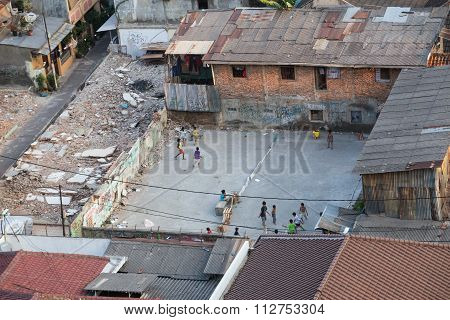 Jakarta, Indonesia - Circa October 2015: Kids Are Playing Games In Slums Of  Jakarta