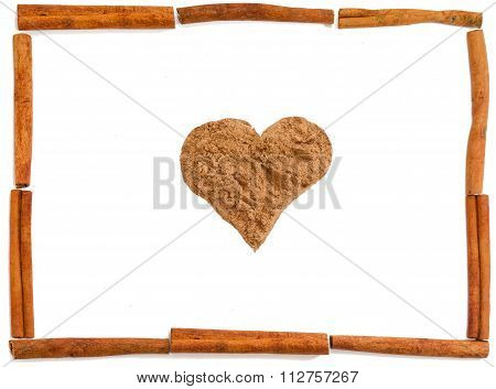 Pile Of Cinnamon As Heart With Frame Of Cinnamon Sticks