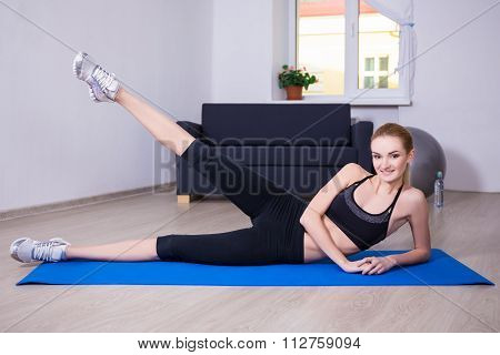 Aerobics Concept - Slim Flexible Woman Doing Stretching Exercise On Yoga Mat