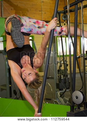 Attractive Woman Does Suspension Training  In The Gym's Studio