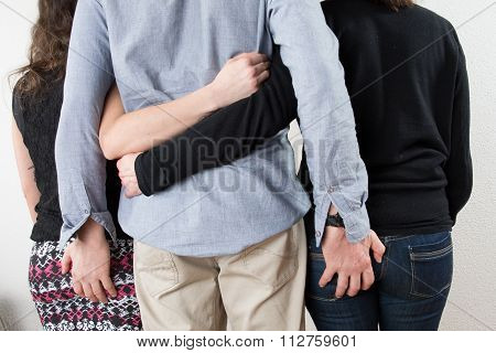 Back Of One Man With Two Women On Each Side