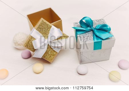 Two gift boxes on vintage wood table