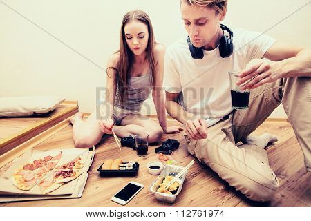 Young Couple Playing Computer Game Home Together, Hobby, Addiction Eat