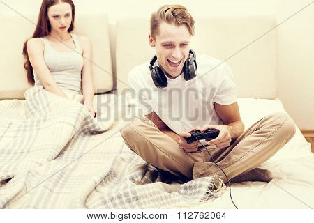 Man Is Playing Playstation Computer Game Woman Girlfriend Is Angry For Him