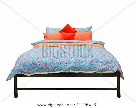 Bed With Colorful Duvet And Cushions
