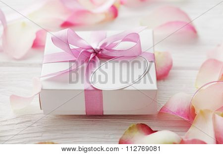gift box with blank gift tag. pink satin gift bow