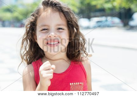 Happy Child In A Red Shirt Outside