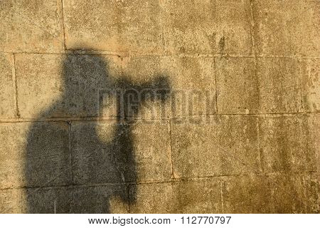 photographer silhouette on wall