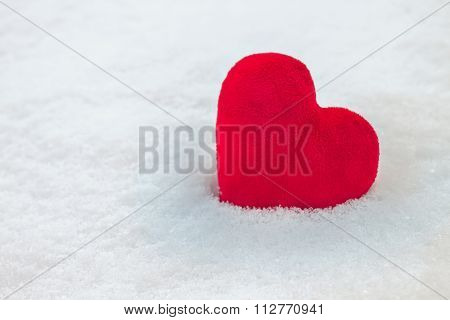 Red Heart On Snow Background