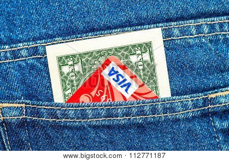 One American Dollar And Credit Card Visa Sticking Out Of The Back Jeans Pocket